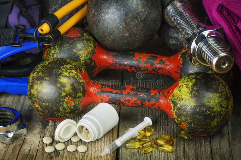 Dumbbells, Sports Gear With Pills Stock Photography