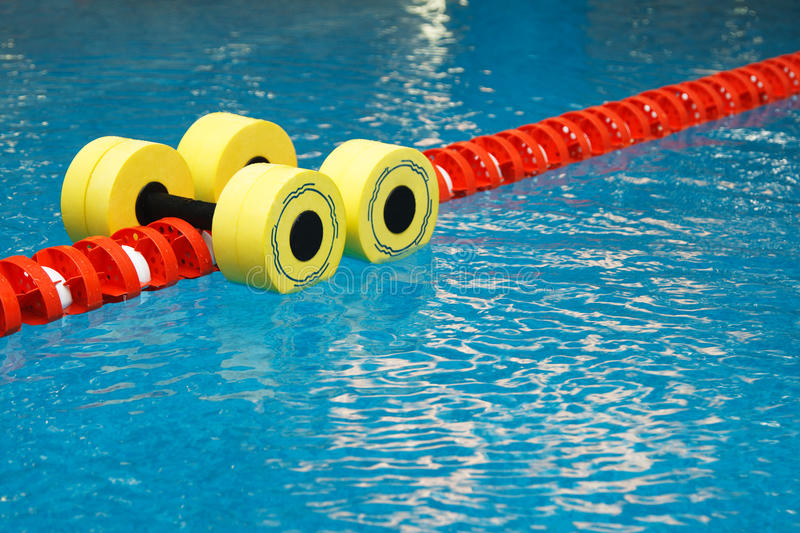 Dumbbells for water aerobics stock photography