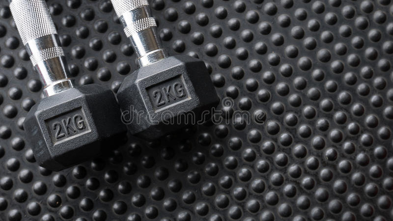 Dumbell for wegiht training in gym.  royalty free stock photography