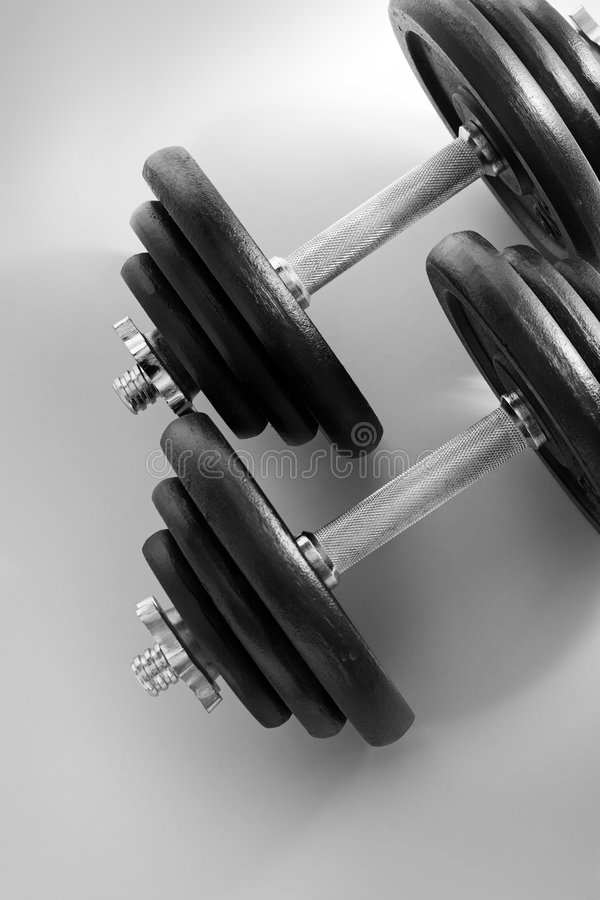 Dumbells. Black & white image of a pair of dumbells stock photo