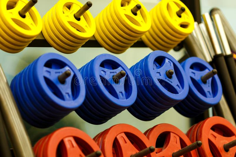 Dumbells for fitness in a rack at the gym,have an exercise. royalty free stock image