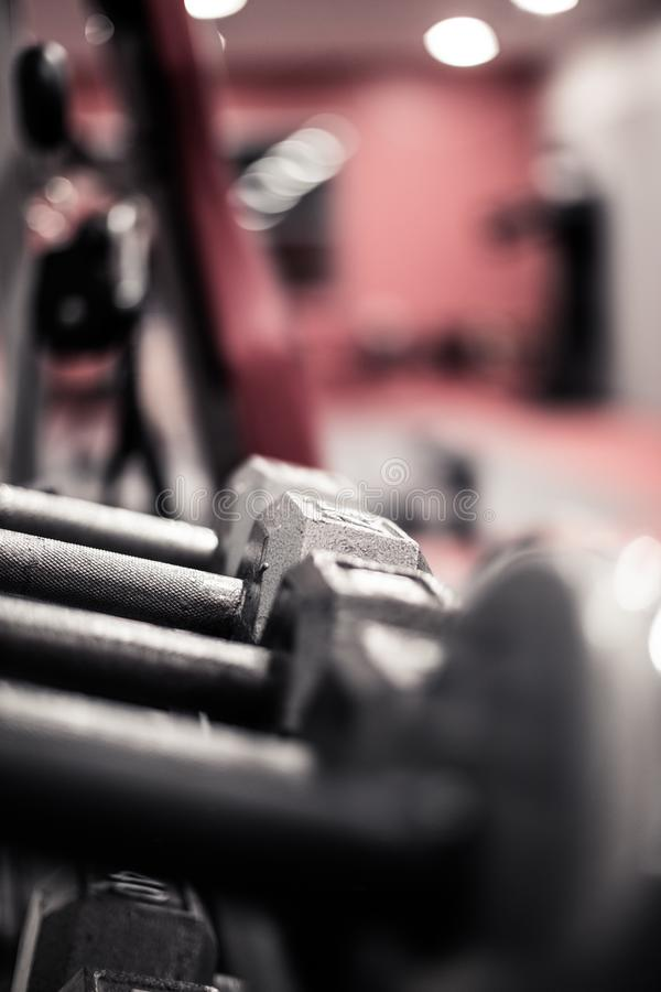 Dumbells in a gym. Dumbells waiting for use in a fitness center / gym royalty free stock photo