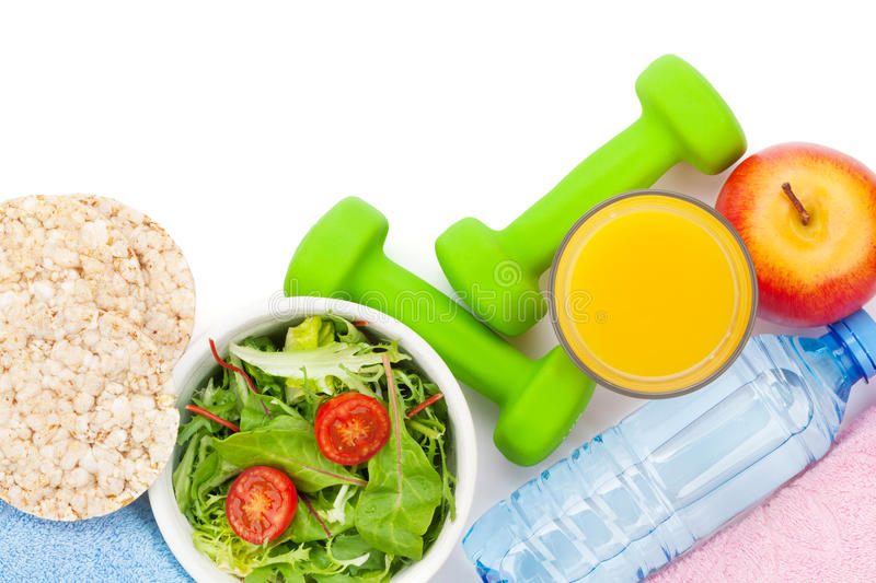 Dumbells, healthy food and towels. Fitness and health. Isolated. On white background stock photo
