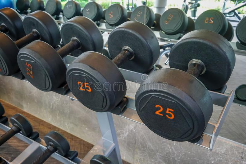 Dumbells set left on the racks in the gym. Healthy or sport concept stock photo