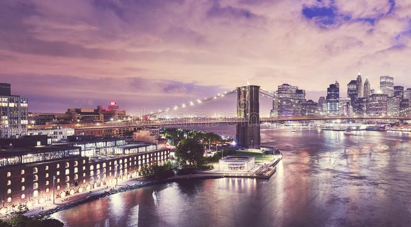 Dumbo and the Brooklyn Bridge at night, NYC. Dumbo neighborhood and the Brooklyn Bridge at night, color toned picture, New York City, USA royalty free stock photo
