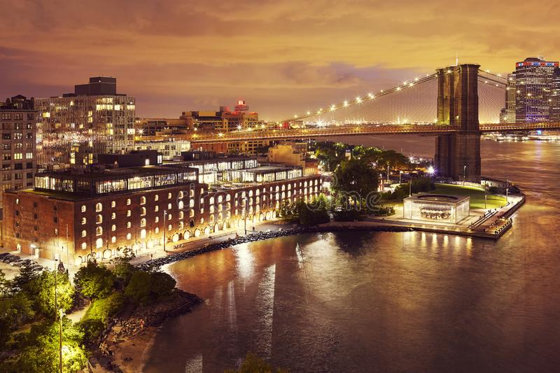 Dumbo and the Brooklyn Bridge at night, NYC. Dumbo neighborhood and the Brooklyn Bridge at night, color toned picture, New York City, USA royalty free stock photos