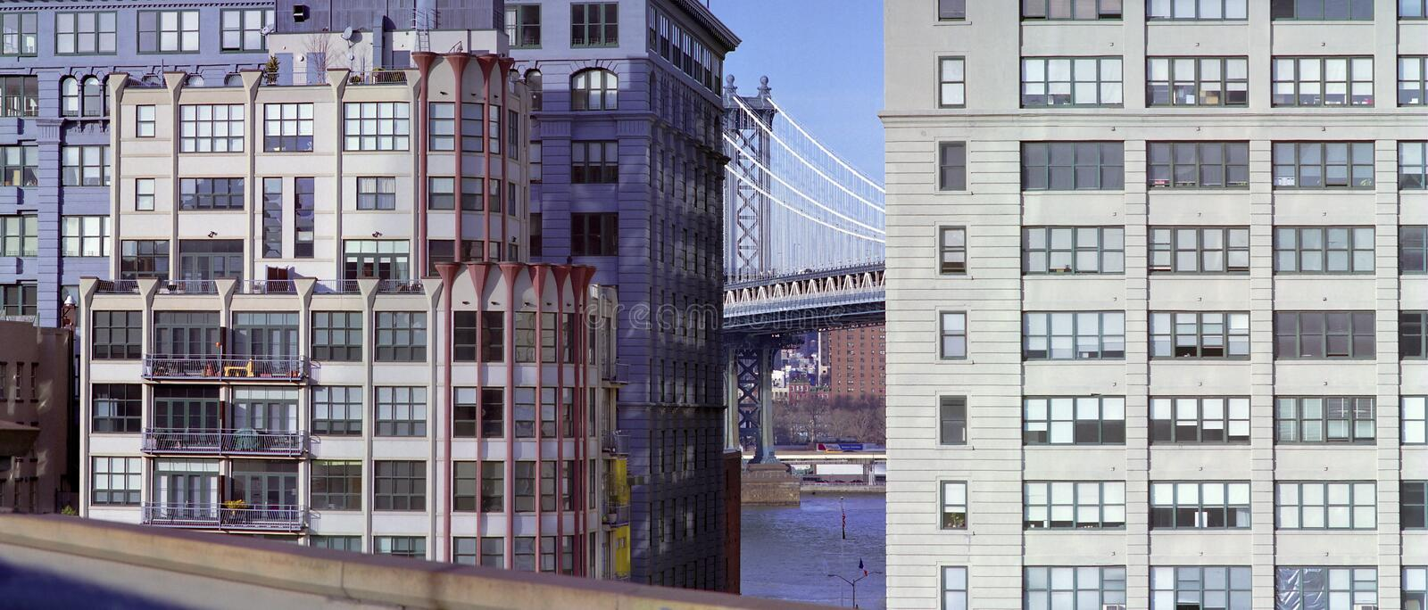 Dumbo District, Brooklyn New York USA. Manhattan Bridge and rehabilitated waterfront luxury buildings in Dumbo section of Brooklyn New York. East River and stock photography