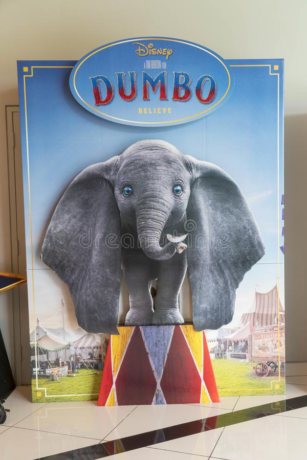 Dumbo movie poster, this movie is about a young elephant, whose oversized ears enable him to fly. KUALA LUMPUR, MALAYSIA - APRIL 3, 2019: Dumbo movie poster royalty free stock photo