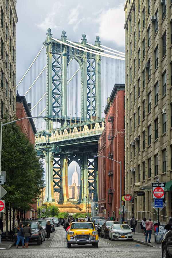 DUMBO and vintage Taxi. With Manhattan Bridge on the background royalty free stock photos