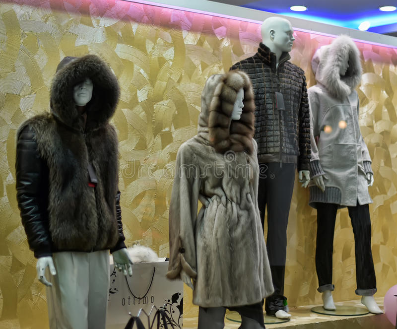 Dummies in fur coats in the shop window royalty free stock photography