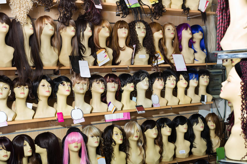 Dummies heads with hair style in shop. Dummies heads with modern hair style periwigs in the shop stock image