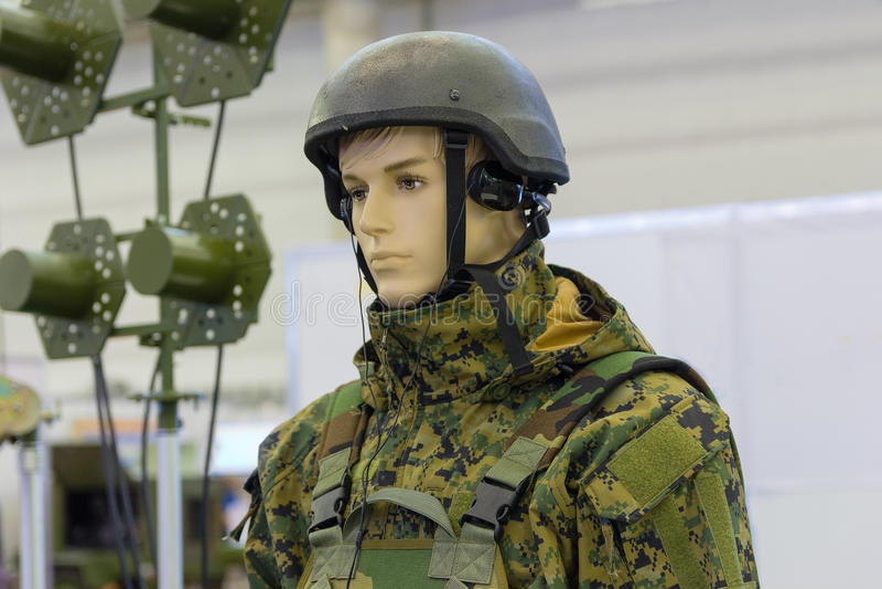 Dummy in army helmet with headphones stock photos