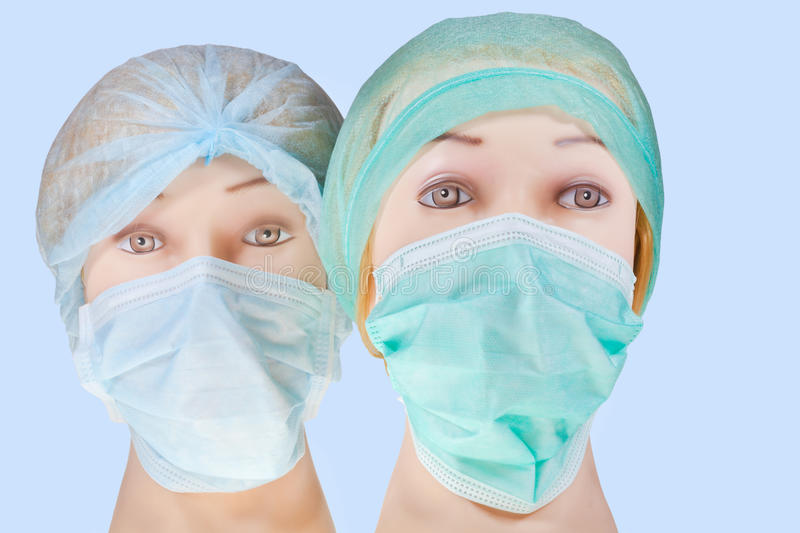 Dummy Cap Heads And Stock Textile Surgical Mask Wearing Doctor