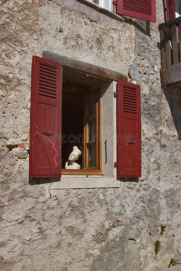 Dummy in a window stock images