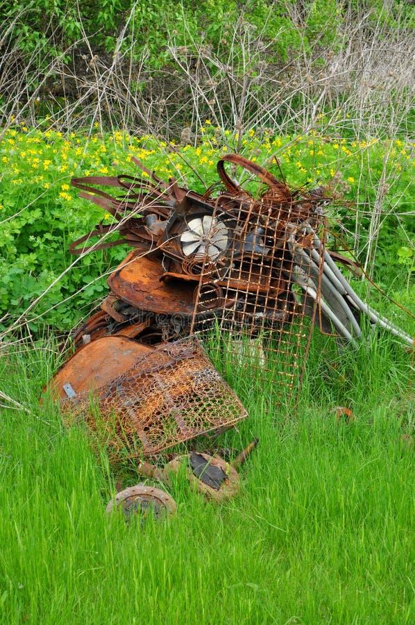 Dump garbage. On green lawn stock image