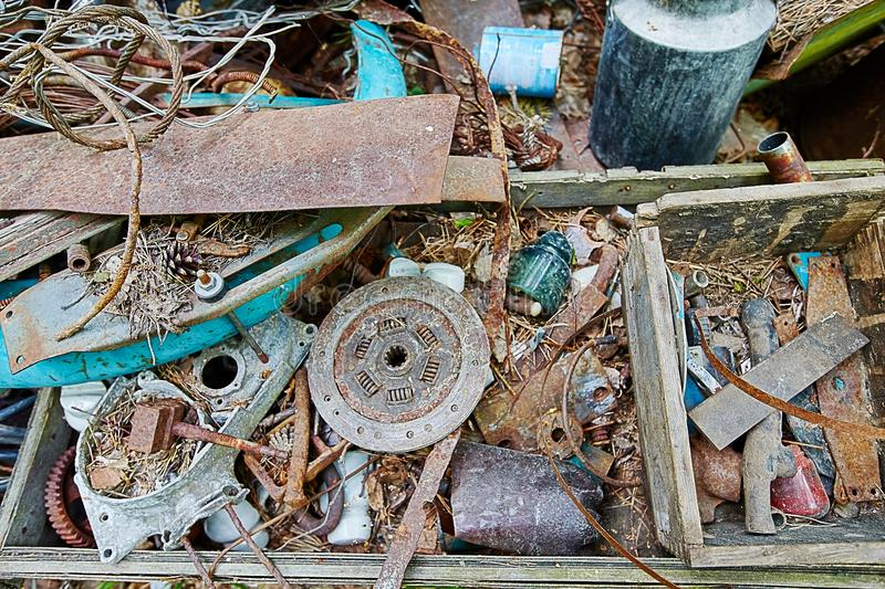 Dump old metal objects in the woods, rusty scrap metal. Environ. Mental destruction and pollution royalty free stock photo