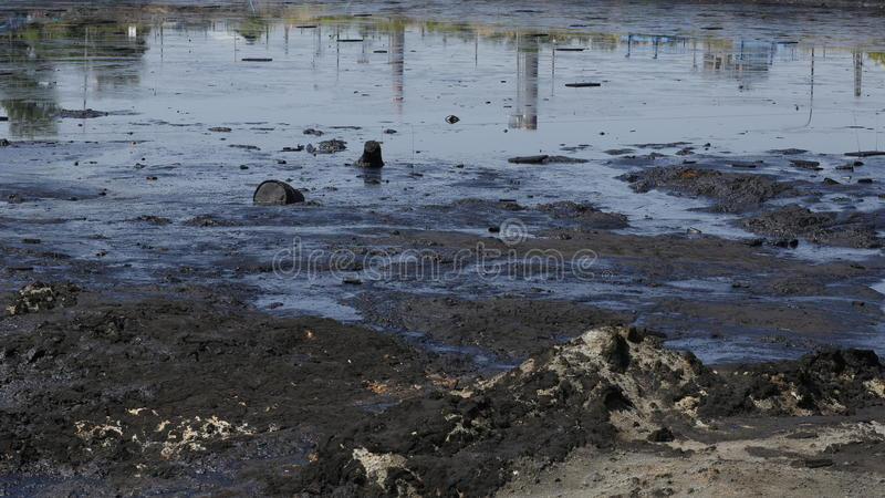 Dump toxic waste, oil lagoon contamination water and soil. Former dump toxic waste, oil lagoon contamination. Nature effects from water and soil contaminated royalty free stock image