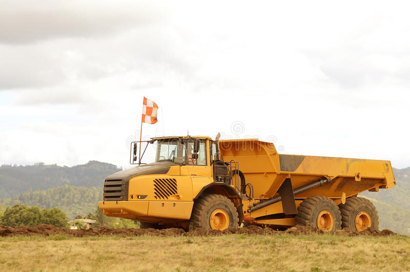 Dump Tractor. Large dump tractor moving dirt and rocks for a airport runway extension project in Oregon stock images