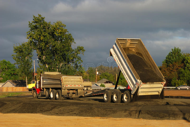 Dump and Trailer. Dump truck and trailer laying down gravel base while working on a new tennis center, Stewart Park, Roseburg OR royalty free stock photo