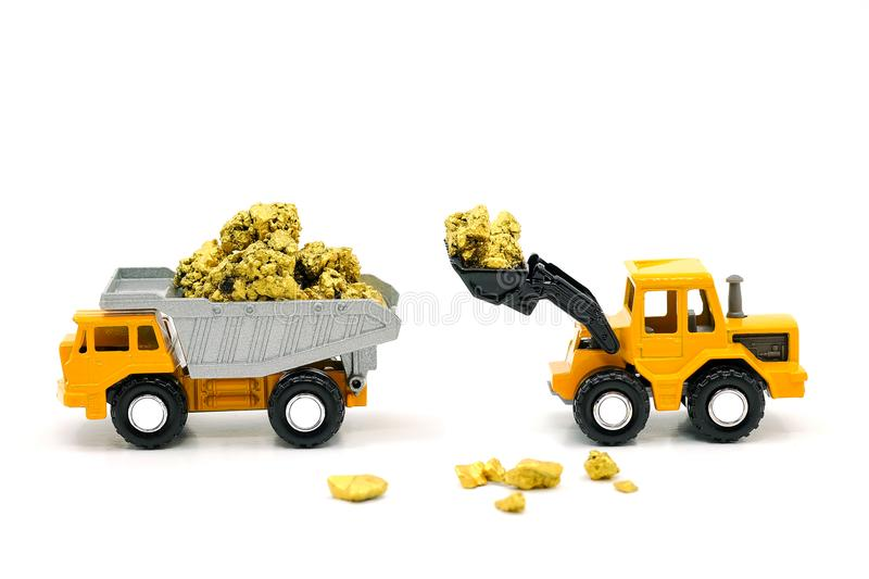 Dump truck and bulldozer Dealing with gold ore mine stock photography