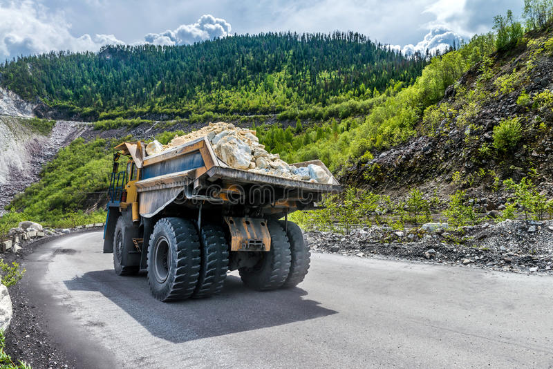 The dump truck carries the stones royalty free stock photo