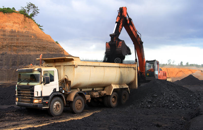 Dump truck at coal mining site royalty free stock image