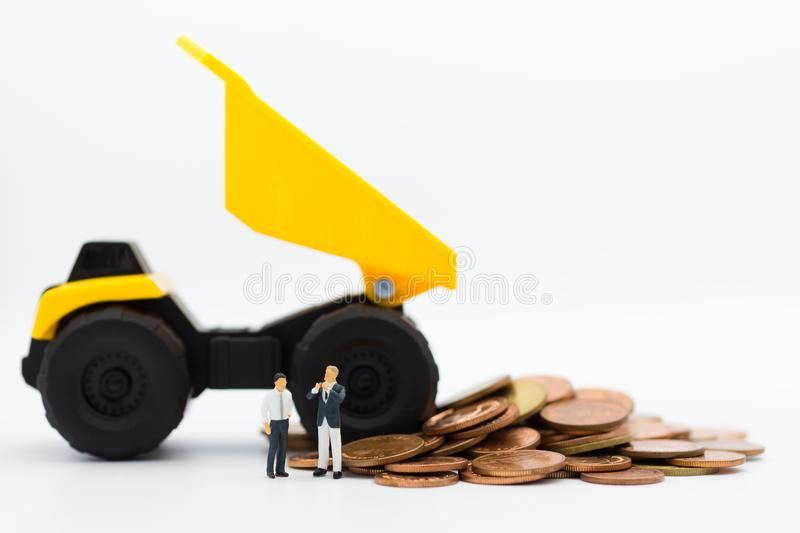 Dump truck pouring coins. Image use for money and business financial concept.  royalty free stock photography