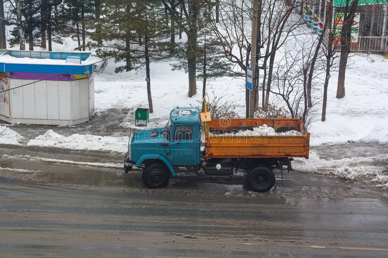 Dump truck with snow. Top view on the dirty roadway stock photos