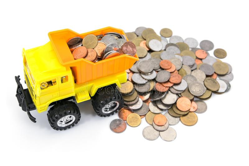 Dump truck toy loading coins isolated on white background. Truck toy load coins moneys royalty free stock photography