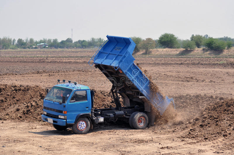 Dump truck. Unload soil on site royalty free stock photos