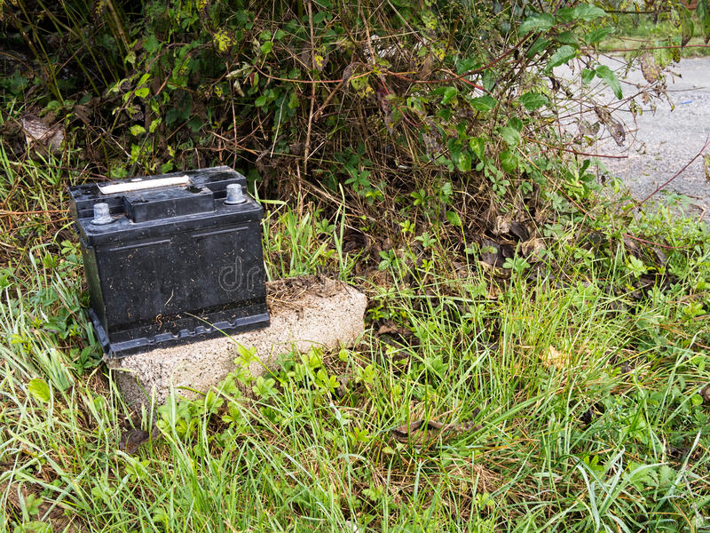 Dumped used car battery. Rubbish disposal, environment problem. No logos etc. Pollution in the countryside royalty free stock photos