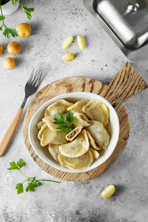 Dumplings, filled with mashed potatoes and liver. Russian, Ukrainian or Polish dish: varenyky, vareniki, pierogi, pyrohy stock image