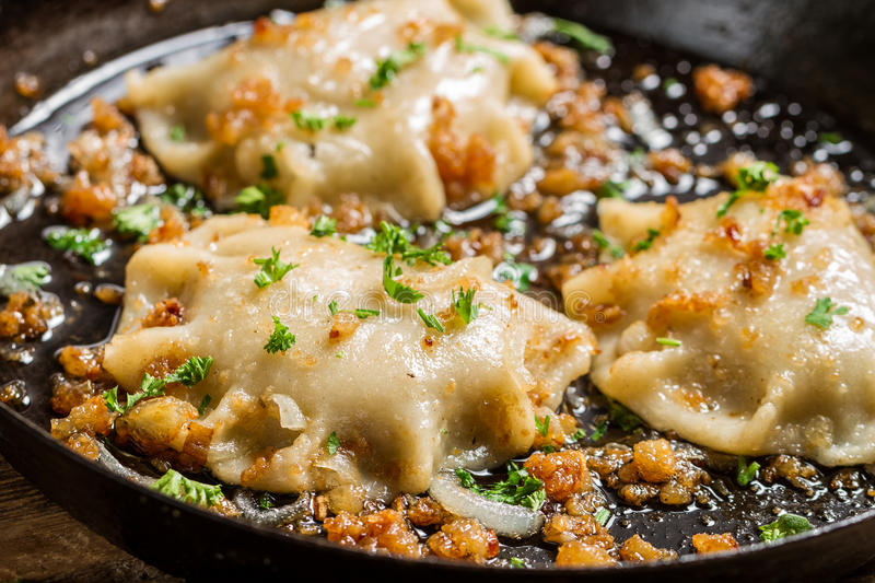 Dumplings fried with onion and parsley royalty free stock photos
