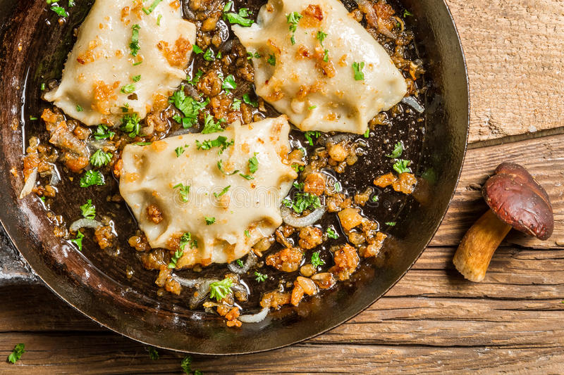 Dumplings with mushrooms, onion and parsley royalty free stock photos