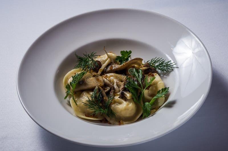 Dumplings with potatoes and mushrooms stock images