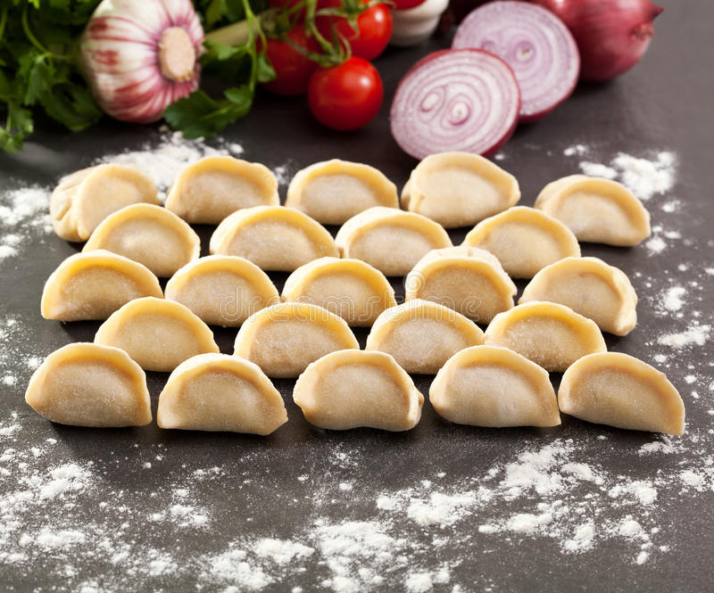 Dumplings. Raw Dumplings on Stone Tray royalty free stock photo