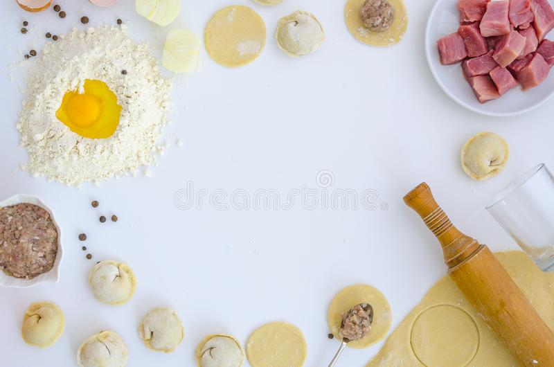 Dumplings raw on white table. Traditional homemade food. The process of cooking dumplings. Pierogi, pelmeni, ravioli royalty free stock photos