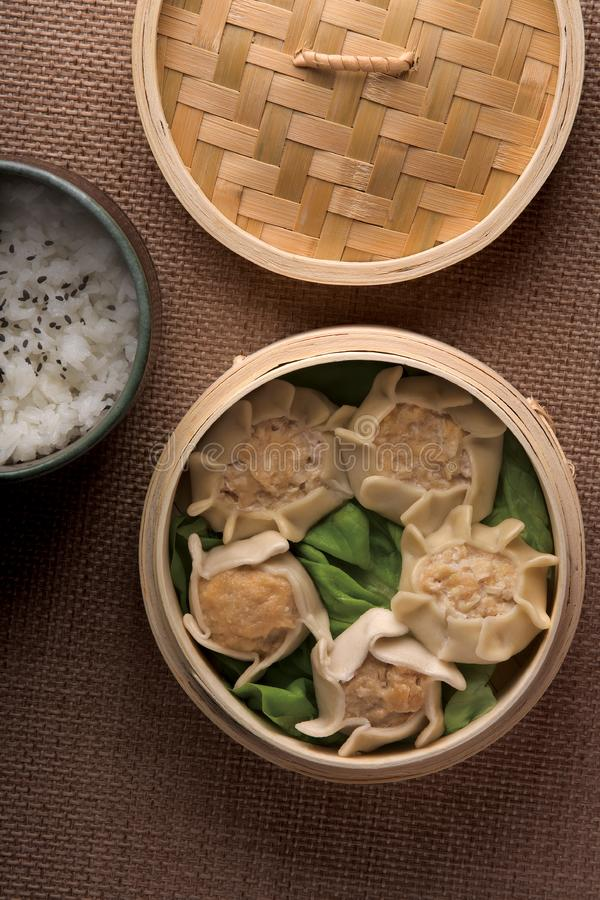 Dumplings And Rice In Baskets Stock Photos