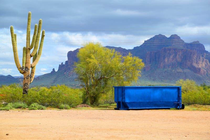 Dumpster. Bright blue dumpster in the Arizona desert royalty free stock image