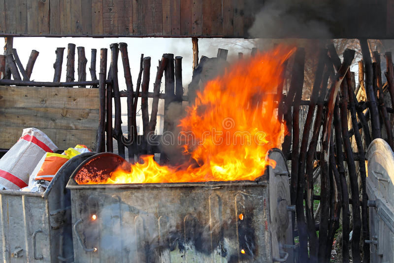Dumpster fire. With heavy smoke from garbage royalty free stock photos