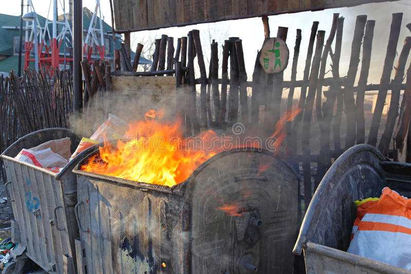 Dumpster Fire. With Heavy Smoke Pollution From Garbage royalty free stock photos