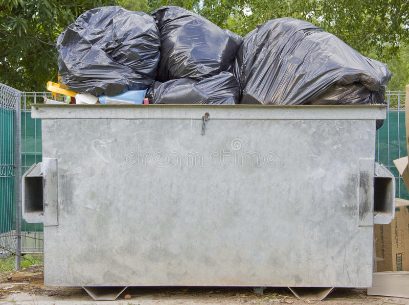 Dumpster full of rubbish. An overfull dumpster bin with clipping path stock photos