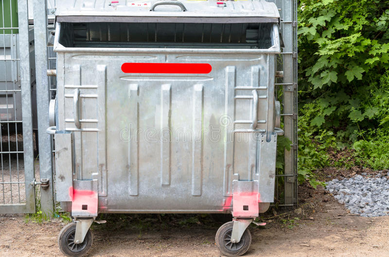 Dumpster. (recycling containers) on a street stock image