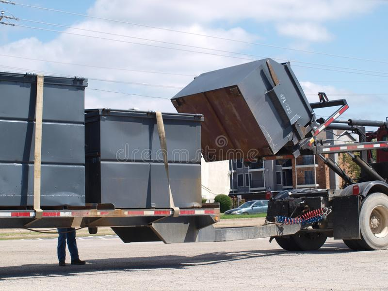 Dumpster Transit with Relocations and Positioning. We all see dumpsters and how they are used and how they are emptied, but seldom, do we see them in transit royalty free stock photos