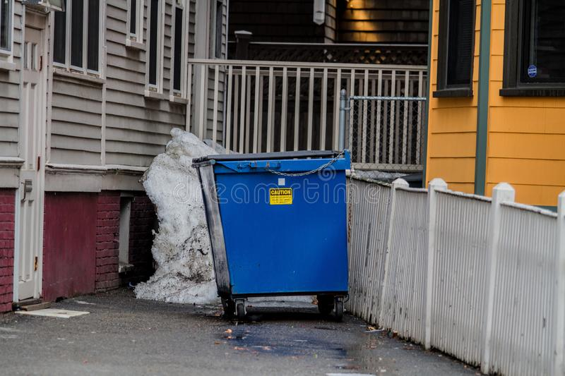 The Dumpster. A dumpster in between two apartments royalty free stock photography