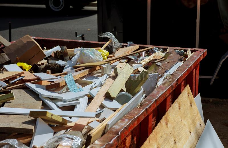 Dumpsters being full with garbage. Container trash on ecology and environment pollution bin can street area big collect collection consume consumer debris dirty royalty free stock image