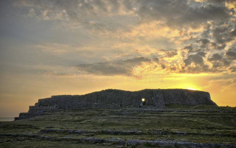 Dun Aengus at sunset. Dun Aonghasa (anglicized Dun Aengus) is the most famous of several prehistoric forts on the Aran Islands of County Galway, Ireland. It is