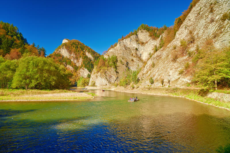 The Dunajec River Gorge mountain landscape. The Dunajec River Gorge. Tourists on raft. Mountain landscape. The Pieniny Mountains, Carpathians royalty free stock image