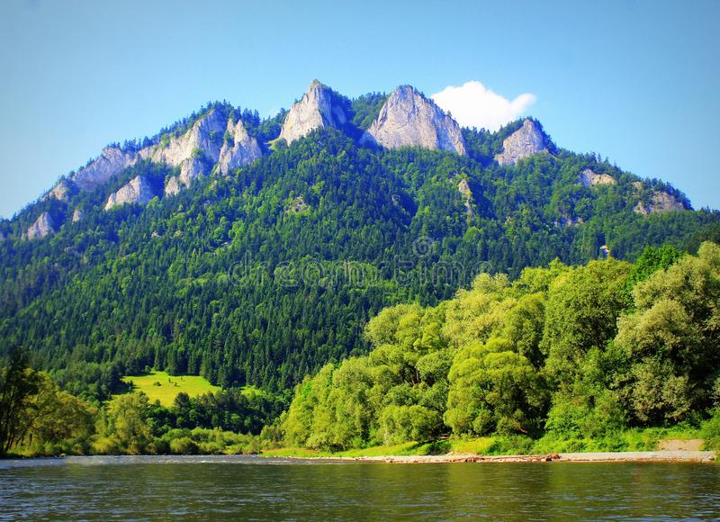 Dunajec river and Three Crowns peak in Pieniny mountains at summer, Poland.  stock photo