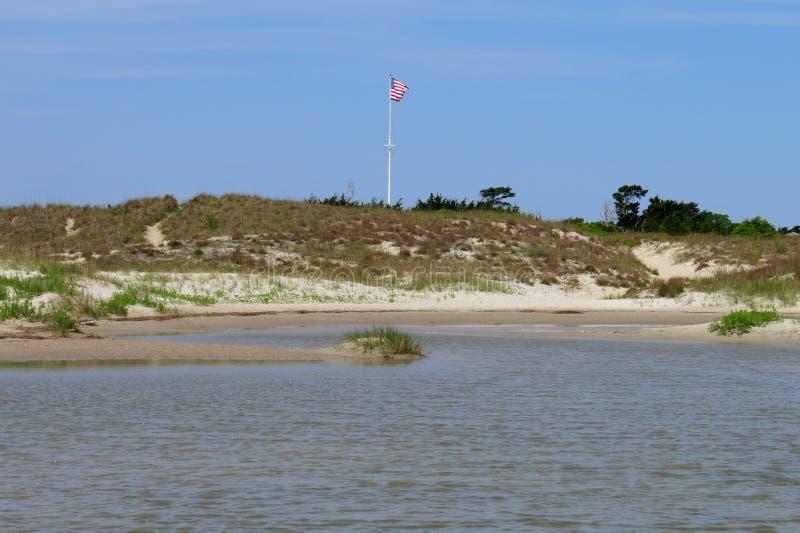 Dunas de arena y piscina de la marea en el fuerte Macon foto de archivo